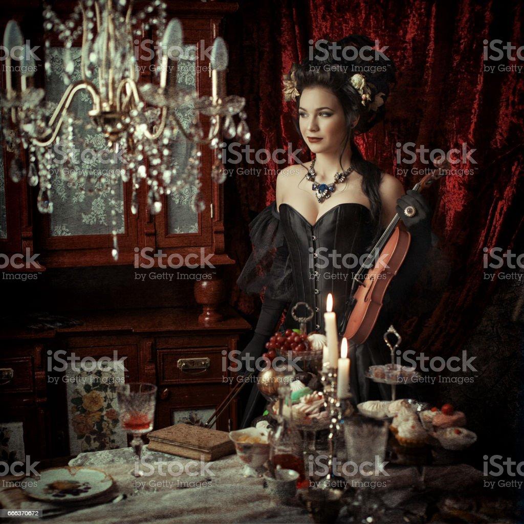Woman in black rococo dress stock photo