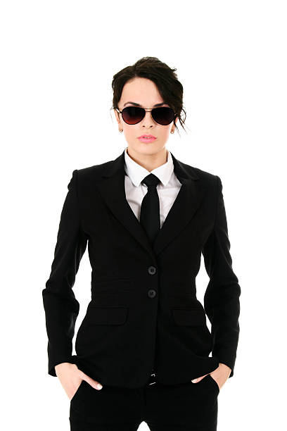 woman in black suit wearing sunglasses and hands in pocket - female spy stock photos and pictures