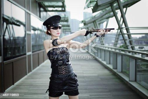 istock woman in black uniform aiming flintlock gun 483119853