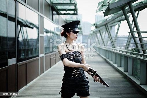 istock woman in black uniform aiming flintlock gun 483119869