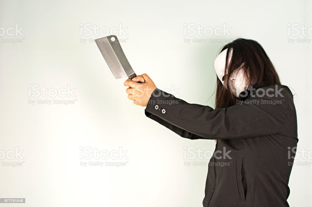 woman in black with white make holding knife on white background. stock photo