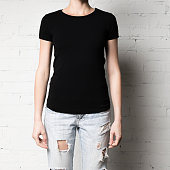 cropped shot of woman in blank black t-shirt