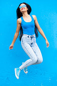 istock Woman in blue colour jumping 870498770