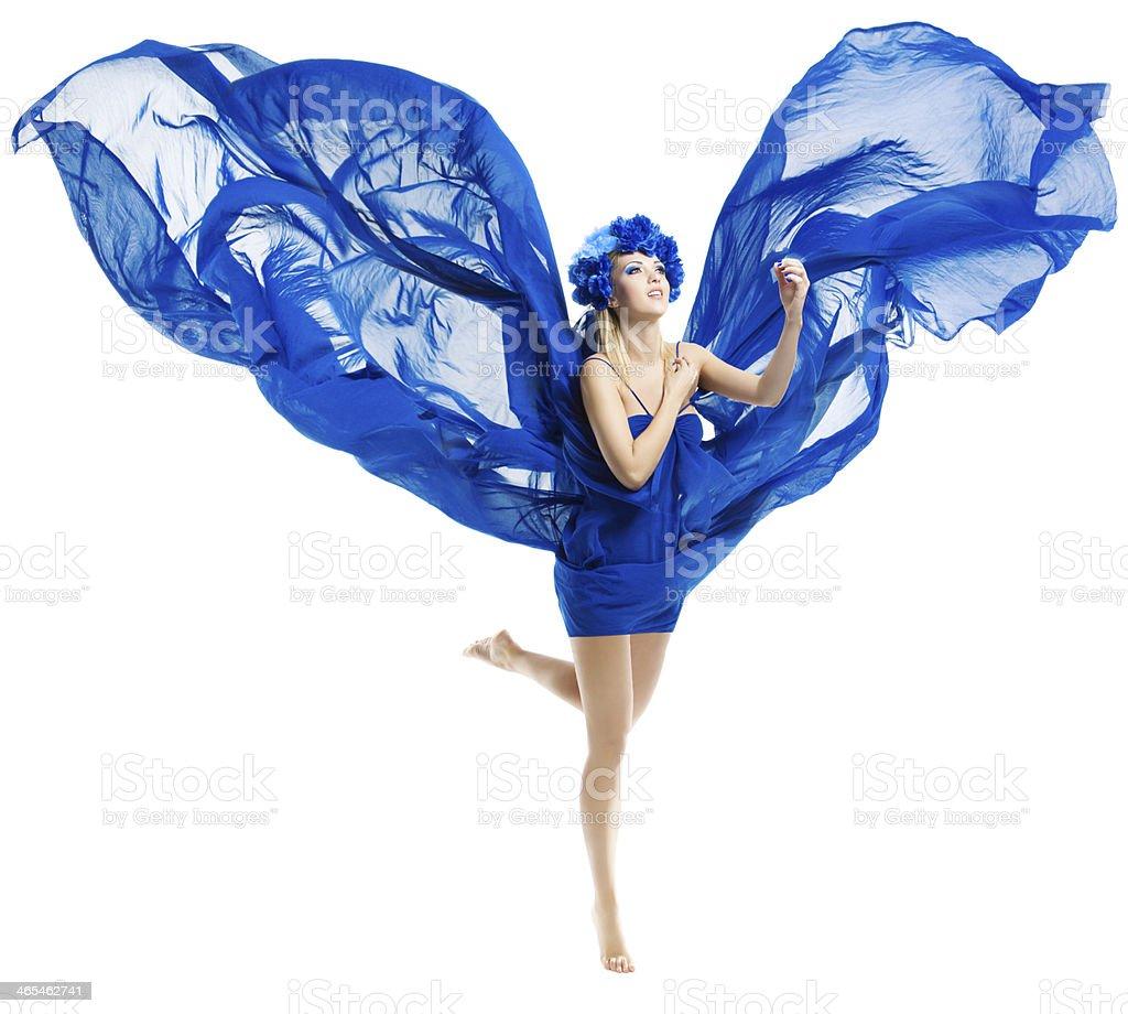 Woman in blue dress wings, waving fluttering fabric stock photo