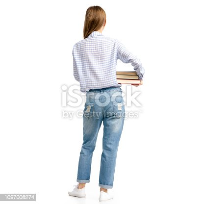istock Woman in blue jeans and shirt with books in hands goes 1097008274