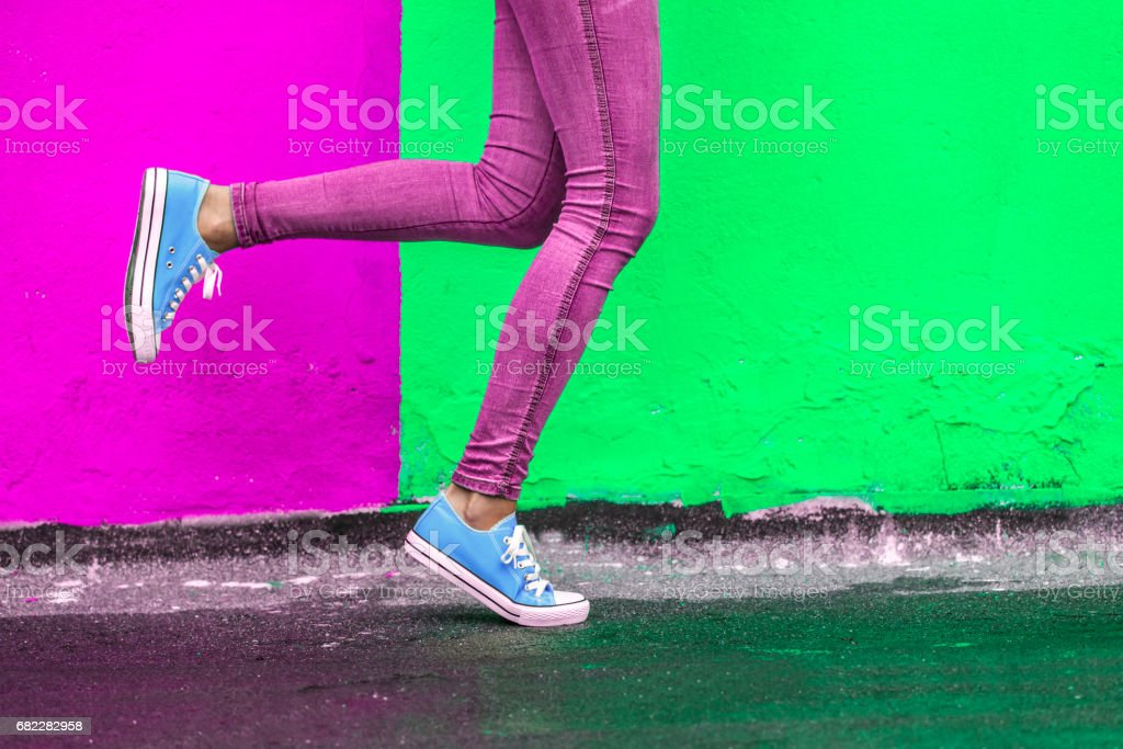 Woman in blue sneakers stock photo