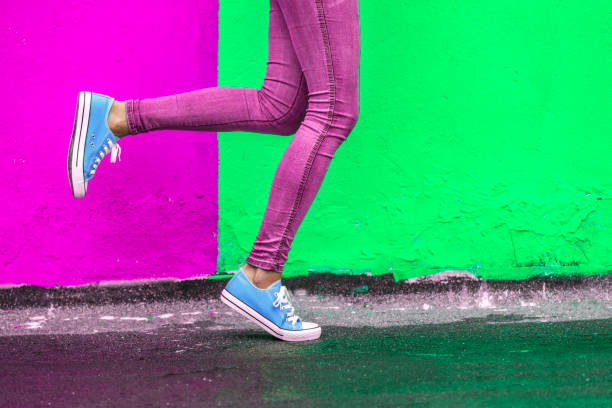 woman in blue sneakers - saturated color stock pictures, royalty-free photos & images