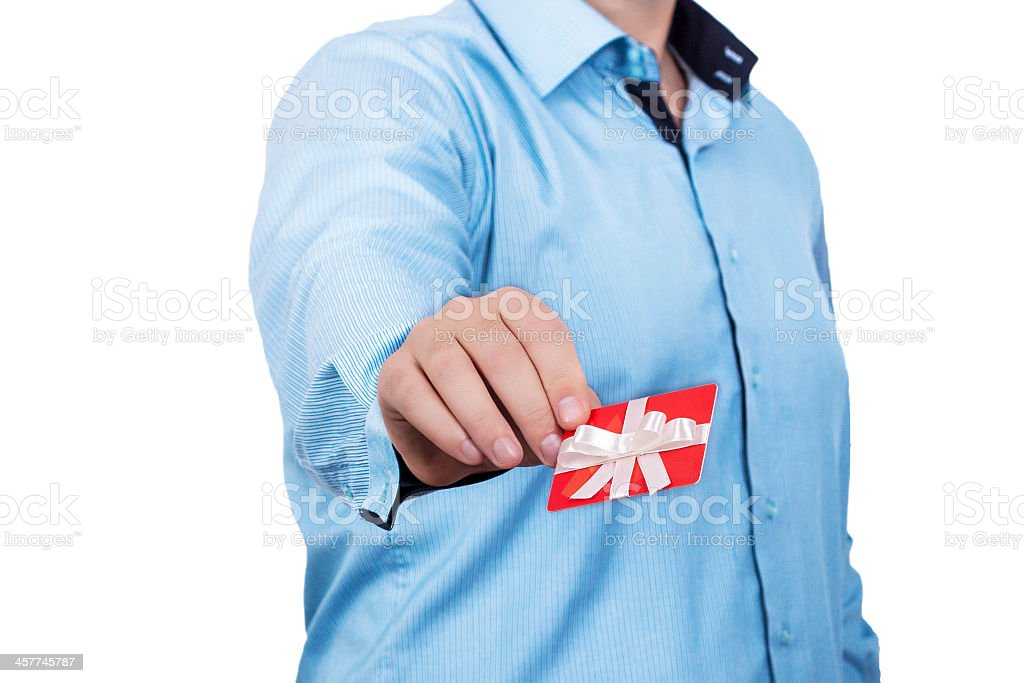 Woman in blue t-shirt holding a red gift card with ribbon stock photo