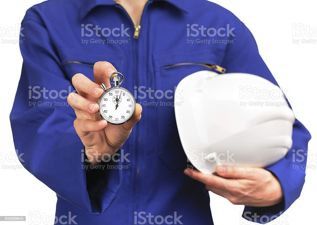 woman in blue work uniform holding a stopwatch stock photo
