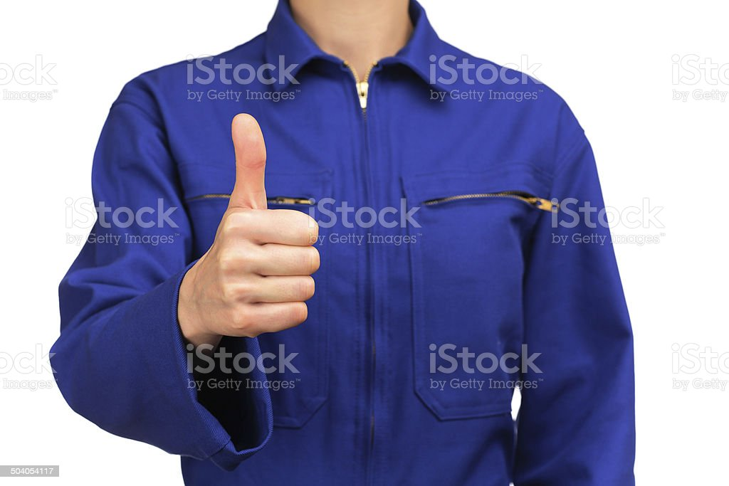 woman in blue work uniform making the OK sign stock photo