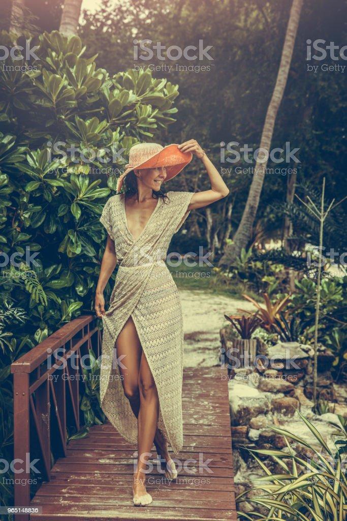 Woman in boho dress in the tropics royalty-free stock photo
