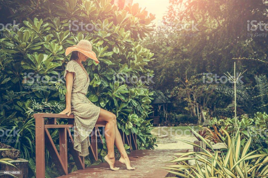 Woman in boho dress in the tropics zbiór zdjęć royalty-free