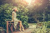 Pretty Woman in boho dress in the tropics