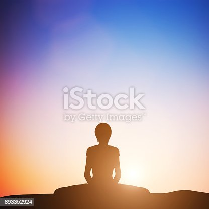 Woman in bound angle yoga pose meditating at sunset. Zen, meditation, peace
