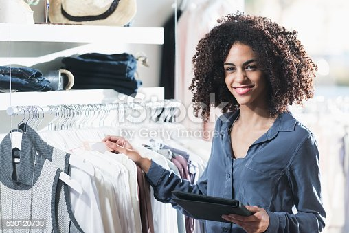 istock Woman in boutique with digital tablet 530120703