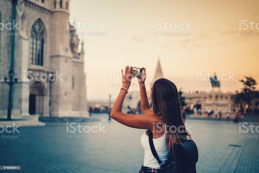 Woman in Budapest photographing the landmarks royalty-free stock photo