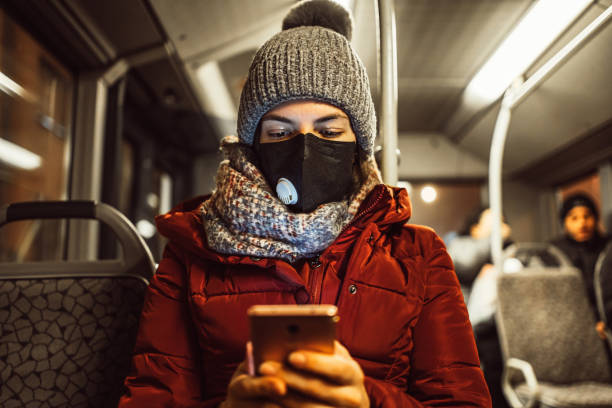 woman in bus wearing face mask - coronavirus stock pictures, royalty-free photos & images