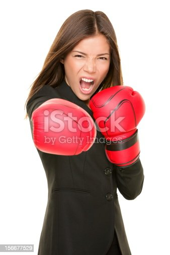 istock Woman in business suit and boxing gloves 156677529