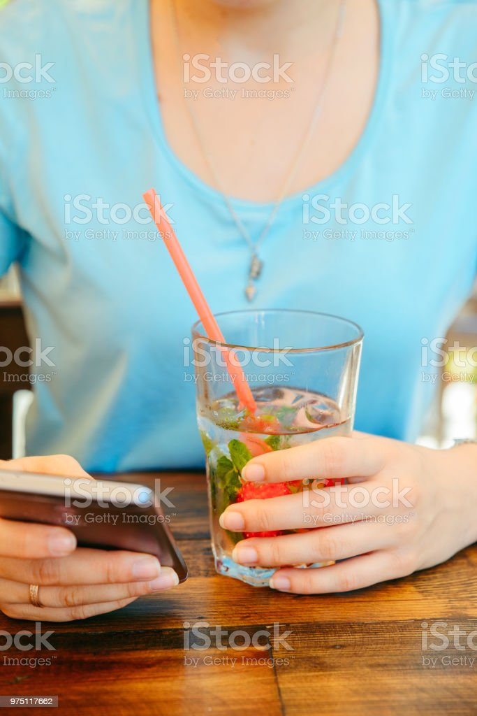 woman in cafe drinking cool drinks close up stock photo