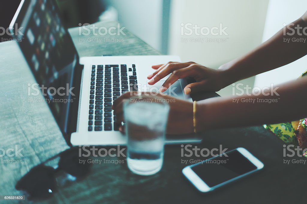 Woman in cafe using laptop stock photo