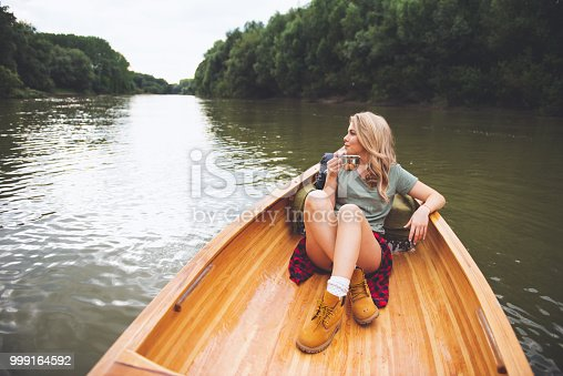 Young woman having a ride in the canoe.