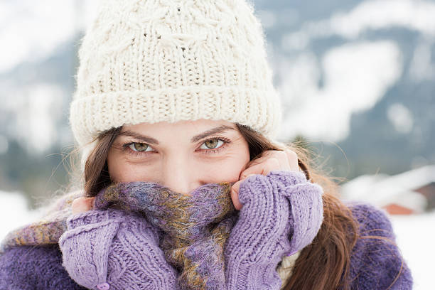 woman in cap, scarf and gloves - warm clothing stock photos and pictures