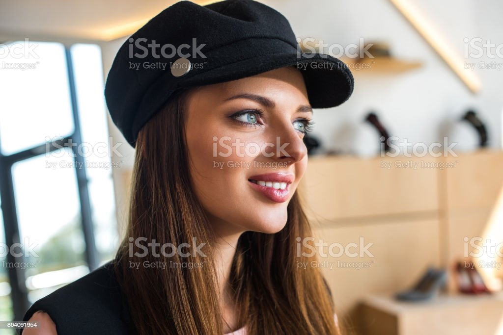woman in cap smiling and looking away royalty-free stock photo