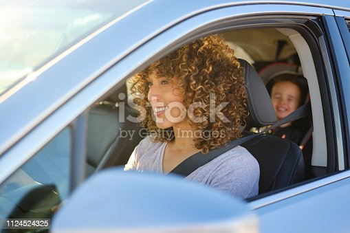 istock Woman in Car with Little Boy 1124524325
