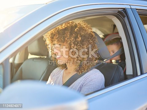 istock Woman in Car with Little Boy 1124524377