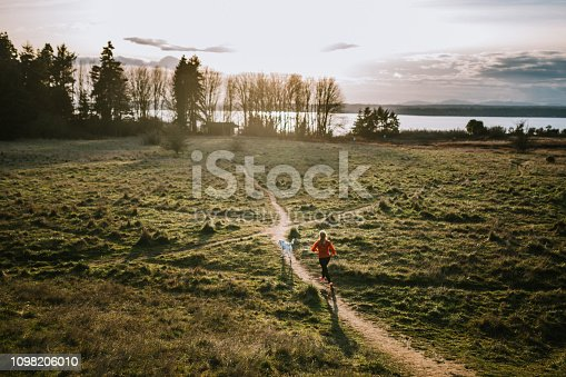 A young adult woman enjoys traveling with her canine companion, headed to some outdoor adventure together.  Shot in Seattle, Washington.