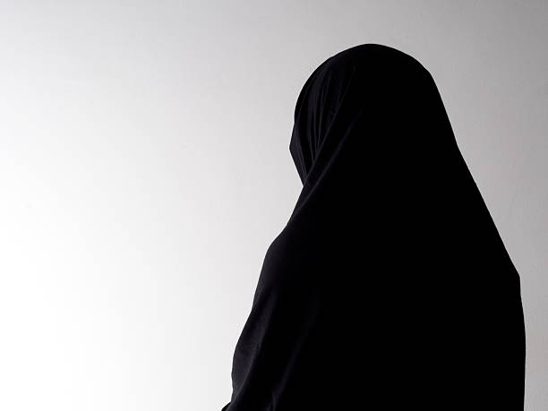 Woman in chador from behind, with copyspace. Woman in chador from behind, with copyspace religious veil stock pictures, royalty-free photos & images