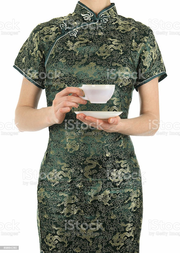 Woman in Chinese dress holding a cup of tea royalty-free stock photo