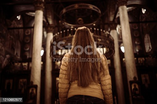 Woman spending some time in the silence of the church