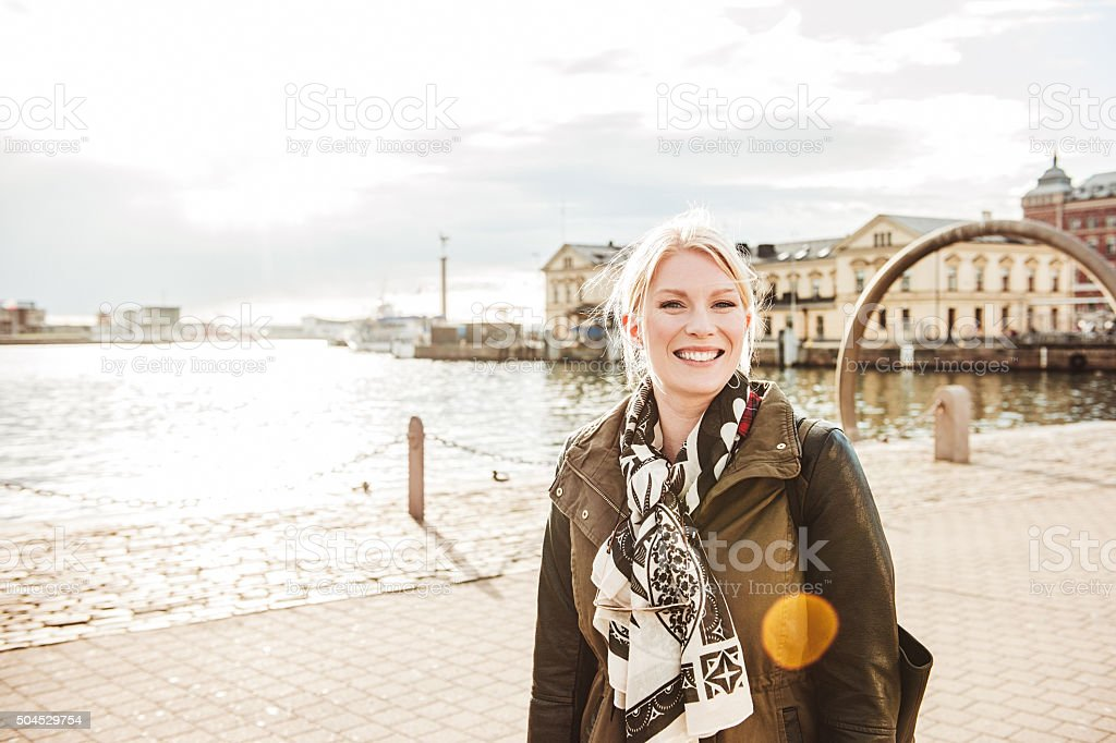 Woman in city in spring sunshine stock photo