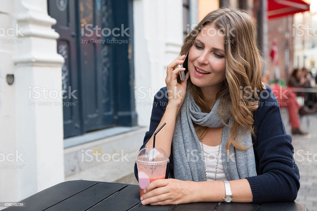 Woman in city using smart phone. royalty-free stock photo