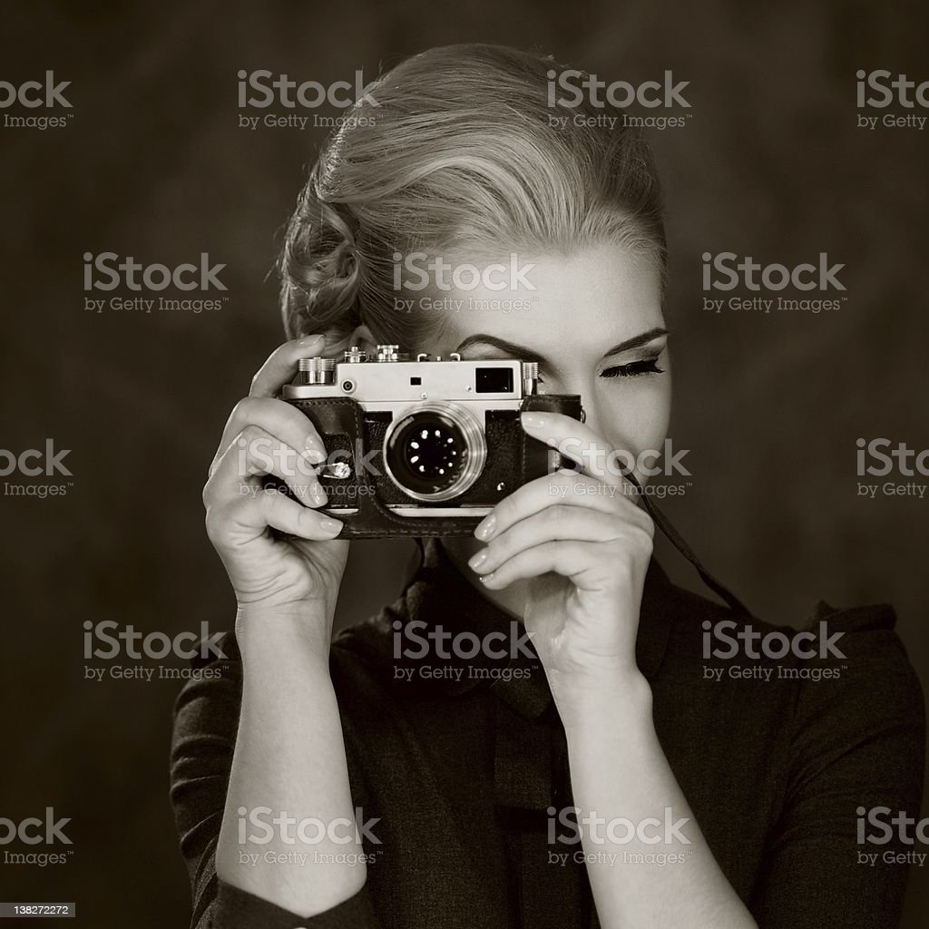 Woman in classic dress with retro camera. stock photo