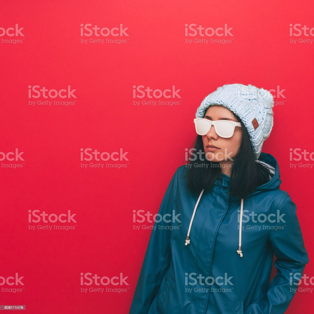Woman in coat and hat stock photo