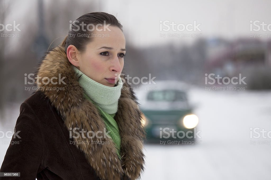 woman in coat on the road royalty-free stock photo