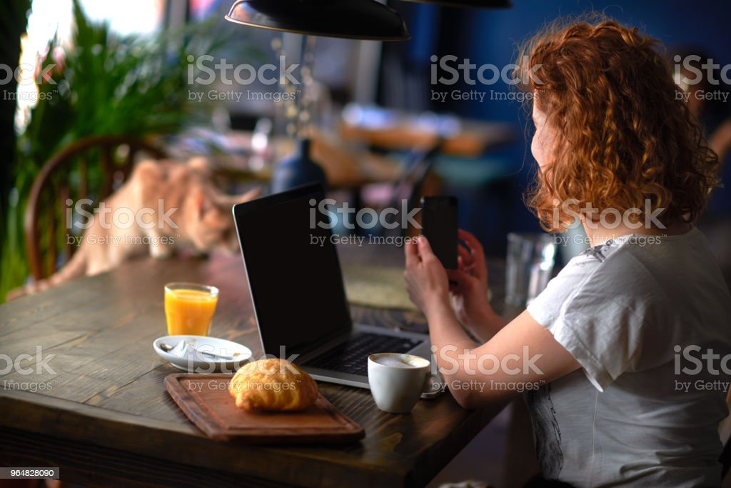 Woman in coffee shop royalty-free stock photo
