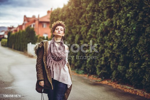 Young beautiful woman in cold temperature downtown