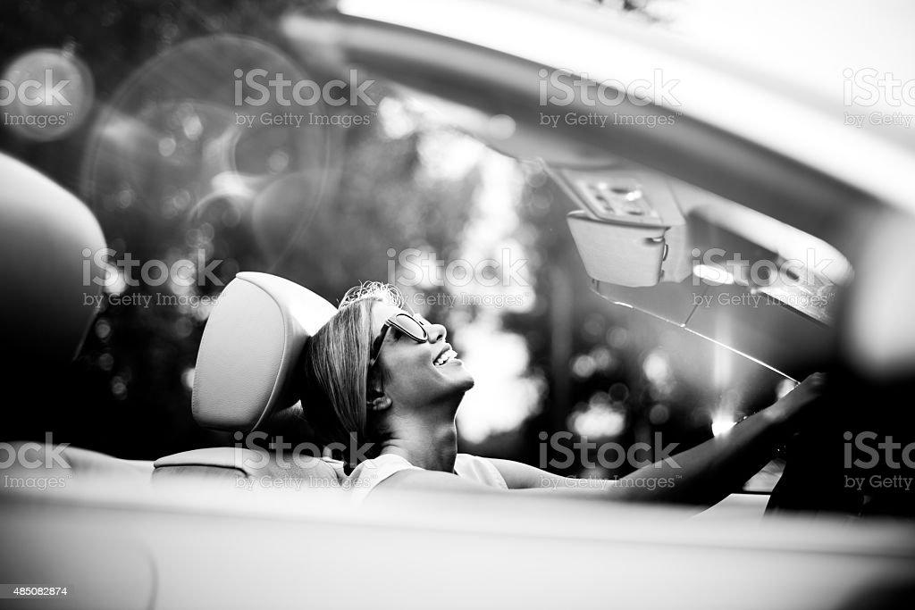 Woman in convertible car stock photo