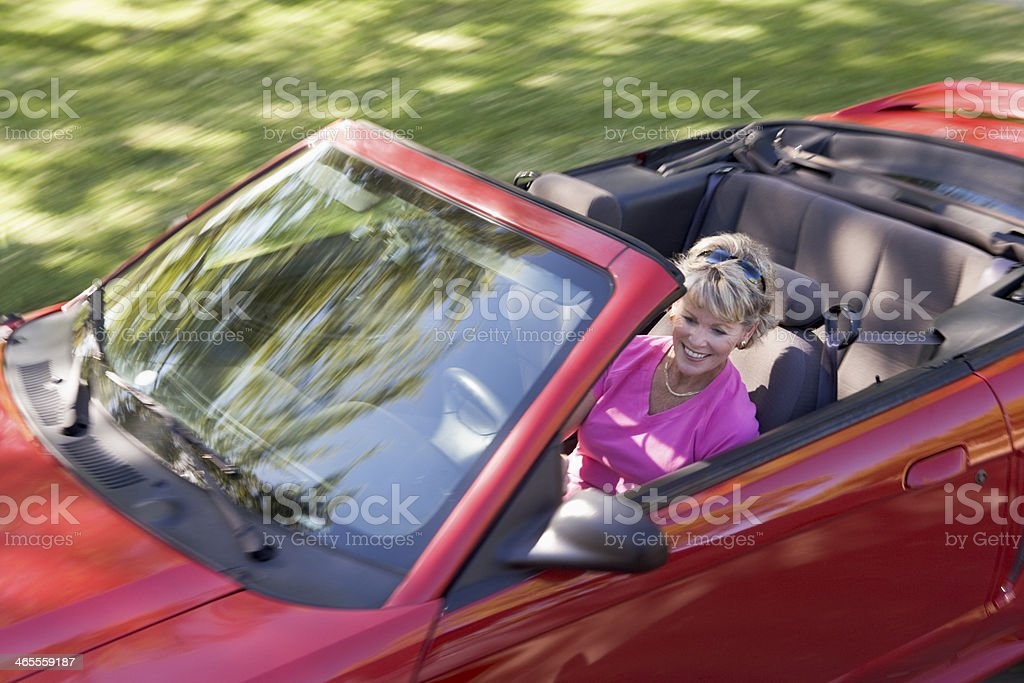 Woman in convertible car smiling royalty-free stock photo