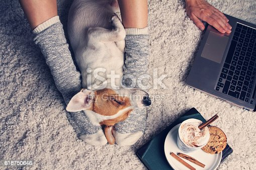 istock Woman in cozy home wear relaxing at home 618750646