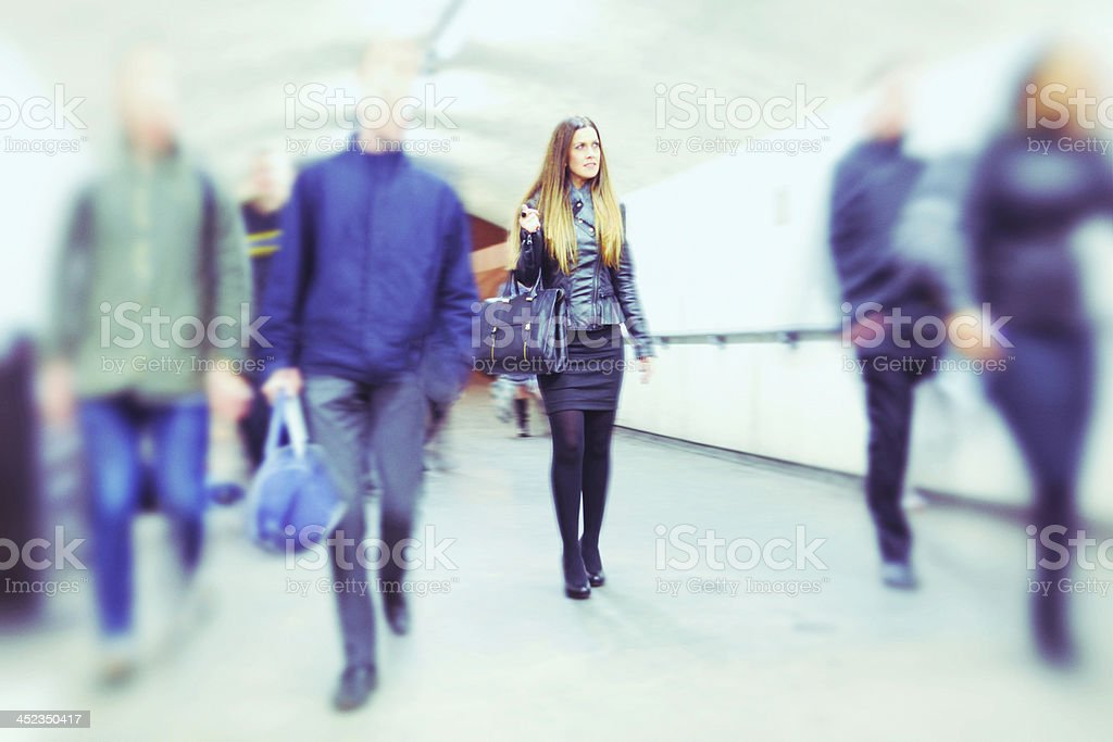 woman in crowd commuting royalty-free stock photo