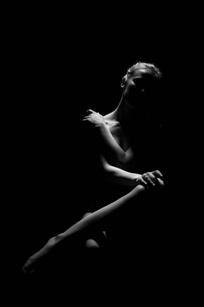 woman in dark stock photo