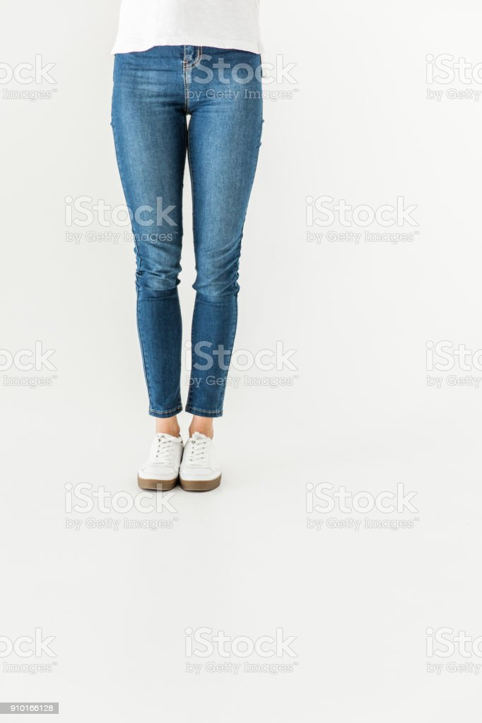 woman in denim pants and shoes standing isolated on white royalty-free stock photo