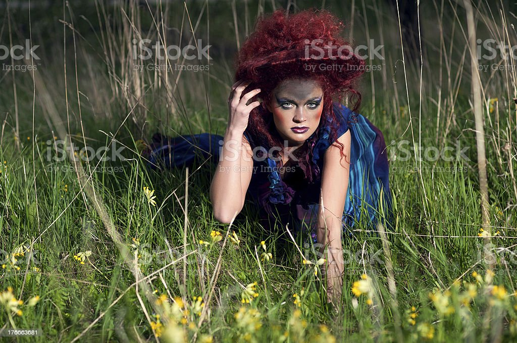 Woman in design hat and dress outdoors royalty-free stock photo