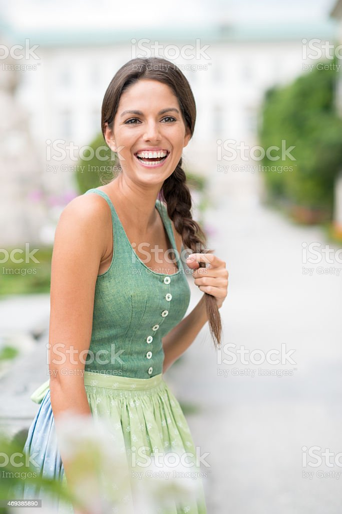 Woman in Dirndl Fashion Laughing stock photo