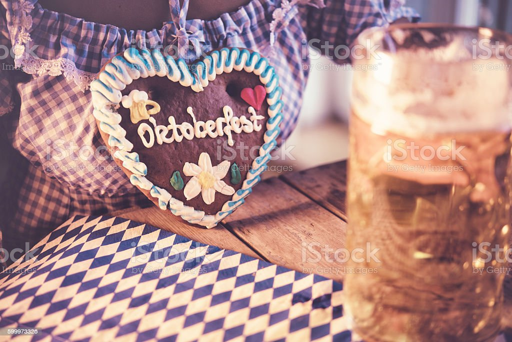 woman in dirndl with beer on oktoberfest table stock photo