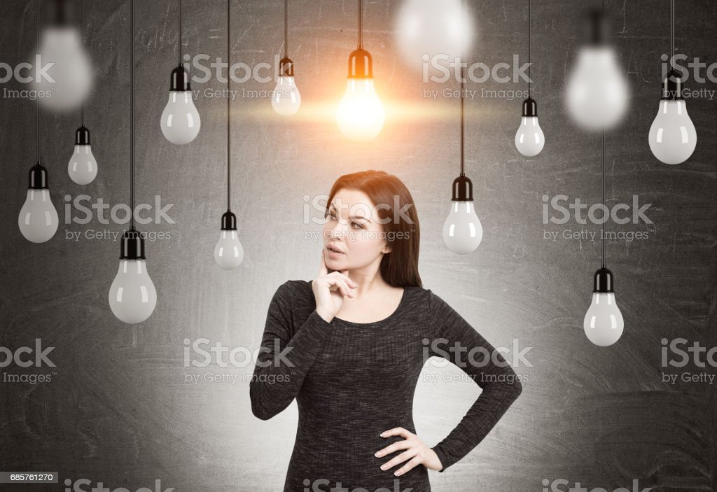 Woman in dress and many light bulbs royalty free stockfoto